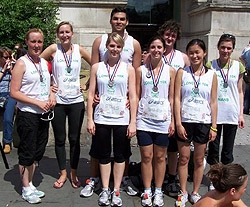 CLT 10K race team with medals